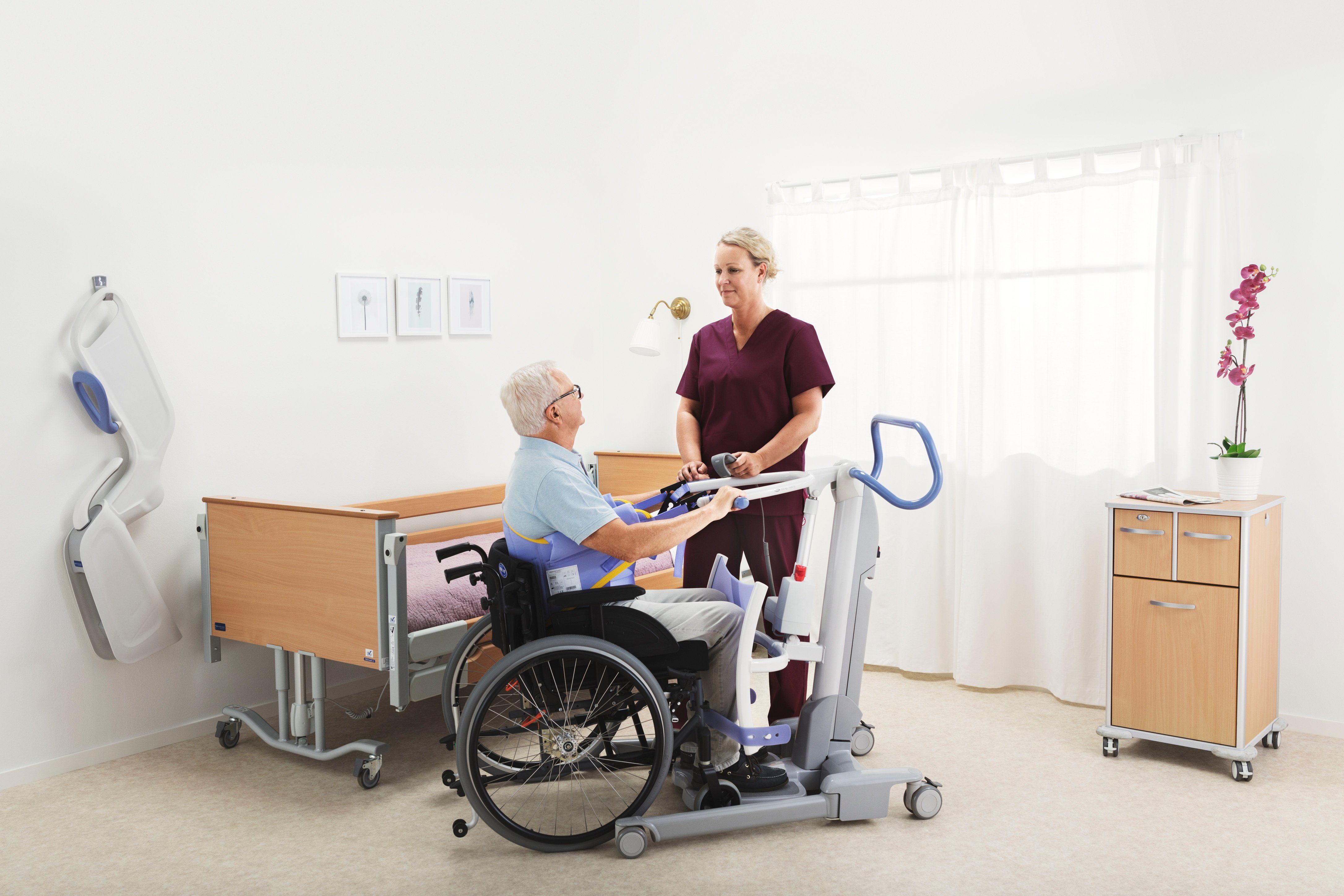How many sit-to-stand transfers do caregivers complete with their patients each day?