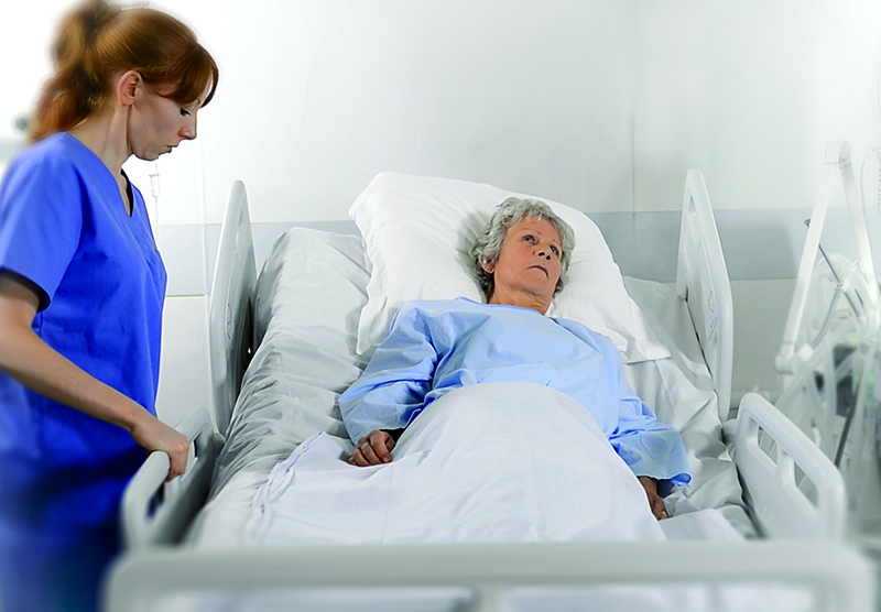 Automated re-positioning of patients in hospital beds